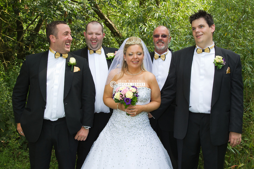 Visually impaired bride and groom with male family members.
