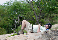 Bear Mountain, New York - A man rests on the rocks at the top of Bear Mountain after hiking up the Appalachian Trail during National Trails Day on June 5, 2010.