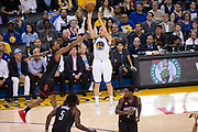 Golden State Warriors guard Klay Thompson (11) shoots a jumper over the Houston Rockets at Oracle Arena in Oakland, Calif., on March 31, 2017. (Stan Olszewski/Special to S.F. Examiner)
