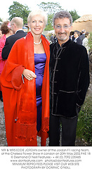 MR & MRS EDDIE JORDAN owner of the Jordan F1 racing team, t the Chelsea Flower Show in London on 20th May 2002.	PAE 18