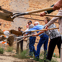 081914       Cable Hoover<br /> <br /> Gallup mayor Jackie McKinney, center, and city council members Yogash Kumar, left, Alan Landavazo, Cecil Gacia and Linda Garcia dig in at a groundbreaking for the El Morro Theatre expansion Tuesday in Gallup.
