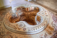 """Eastern Roman Byzantine walk in baptismal font from the 6th century AD Parish Church of Demna near Kalibia, Cape Bon, Tunisia. <br /> <br /> The baptismal font was removed from the church and restored in the Bardo Museum Tunis in 1955. <br /> <br /> The mosaic iconographic decorations represent the salvation of the neophyte, newcomer, who by being baptised is admitted into the Church of Christ whilst being illuminated by faith, represented the mosaic lit candle illustrations.<br /> <br /> The P with a cross through it is the Chi Rho, a Christian symbol which represent the first two letters of Jesus Christ's name in Greek. The Christogram also has the Greek letters Alpha and Omega which represent the passage from the book of revelations: """"I am the Alpha and Omega"""" Chapter 1 verse 8, which is clarified by """"the beginning and the end"""" (Revelation 21:6, 22:13). <br /> <br /> In these type of baptismal fonts those being baptised would have been fully immersed in water as John the Baptist immersed Jesus. <br /> <br /> The font was paid for by donation by Iuliana and Aquinius who dedicated the font to St Cyprian, the martyed Bishop of Carthage, circa 258,  and the author of a treatise on baptism rites<br /> <br /> The Bardo Museum Tunis"""