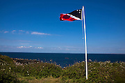 Flag of the Prince of the Saltee Islands, on Great Saltee off the coast of Co. Wexford, Ireland. This flag greets visitors to the island, along with a monument setting out the laws that govern the island. In December 1943 the Saltees were purchased by Michael Neale, who styled himself Prince Michael the First, and entered into a protracted dispute with the Irish authorities. After his death in January 1998 the islands are were passed on to his five sons Michael - now the prince, John Manfred, Paul, Richard, and his daughter Anne. The island is open to free daily visits for anyone who wants to visit and experience its incredible wildlife. The Saltees Flag is made up of three colours: black and red divided by a white banner, with seven stars, each representing Prince Michael and Princess Anne's children. The black star represents a child that died at birth.