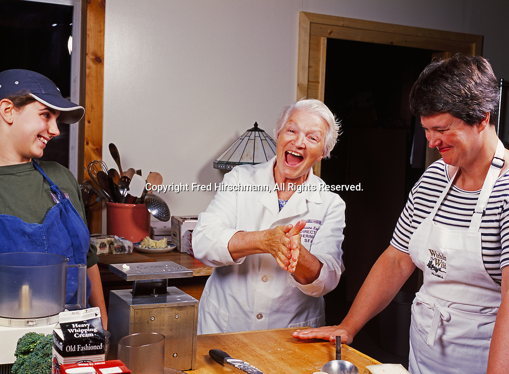 Sara Spudowski and Patty Park enjoying cooking seminar led by French chef Madeleine Kamman at Kirsten and Carl Dixon's Winterlake Lodge, Alaska.