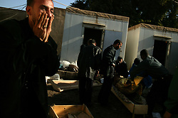 An Iraqis reaction is seen after identifying a relative's body at the Al Karah hospital morgue in Baghdad, Iraq, Feb. 11, 2004. A suicide attacker detonated a car packed with explosives in a crowd of hundreds of Iraqis waiting outside a Baghdad army recruiting center Wednesday, killing up to 46 people in the second bombing in two days targeting Iraqis working with the U.S.-led coalition. The attack backed threats that insurgents would step up violence to disrupt the planned June 30 handover of power to the Iraqis.