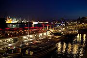 Landungsbrücken harbourside on the Elbe at night, Hamburg, Germany.