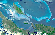 Six marine clusters that represent the main diversity of coral reefs and associated ecosystems in the French Pacific Ocean archipelago of New Caledonia and one of the three most extensive reef systems in the world. August 23, 2003. Satellite image.