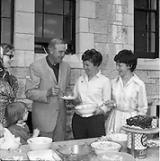 04/07/1961<br /> 07/04/1961<br /> 04 July 1961<br /> United States Embassy Fourth (4th) of July (Independence Day) Party in Navan, Co. Meath. U.S. Ambassador Edward Grant Stockdale tries the food.