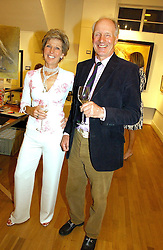 GINA SOPWITH and CHARLES PALMER-TOMKINSON at an exhibition of art by Sam Sopwith held at 27 Cork Street, London W1 on 23rd May 2006.<br />