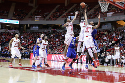 """20 January 2017:  Daouda """"David"""" Ndiaye (4) towers over several other players to grab a rebound during an NCAA Missouri Valley Conference mens basketball game Where the Purple Aces of Evansville lost to the Illinois State Redbirds 75-73 in Redbird Arena, Normal IL"""