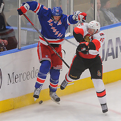 April 12, 2012: New York Rangers defenseman Marc Staal (18) checks Ottawa Senators center Jason Spezza (19) during third period action in game 1 of the NHL Eastern Conference Quarter-finals between the Ottawa Senators and New York Rangers at Madison Square Garden in New York, N.Y.