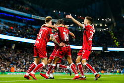 Bobby Reid of Bristol City celebrates with Jamie Paterson, Korey Smith and Josh Brownhill after scoring a goal from the penalty spot to make it 0-1 - Rogan/JMP - 09/01/2018 - Etihad Stadium - Manchester, England - Manchester City v Bristol City - Carabao Cup Semi Final First Leg.