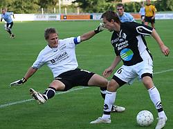 Carsten Fredgaard (Randers FC) presses af målmand Michael Skjold Hansen (Elite 3000).