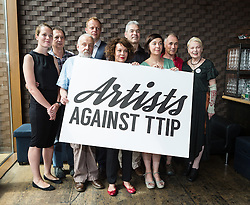 © Licensed to London News Pictures. 02/07/2015. London, UK. CARRIE CRACKNELL, DAVID LAN, MIKE LEIGH, NICK DEARDEN, HELEN McCRORY, JOHN HILARY, VICKY FEATHERSTONE, MARK RYLANCE, VIVIENNE WESTWOOD at an artists against Transatlantic Trade and Partnership (TTIP) photocall at the New Vic Theatre in London. The TTIP is a free trade and investment treaty currently being negotiated between the European Union and the USA. Photo credit : Vickie Flores/LNP