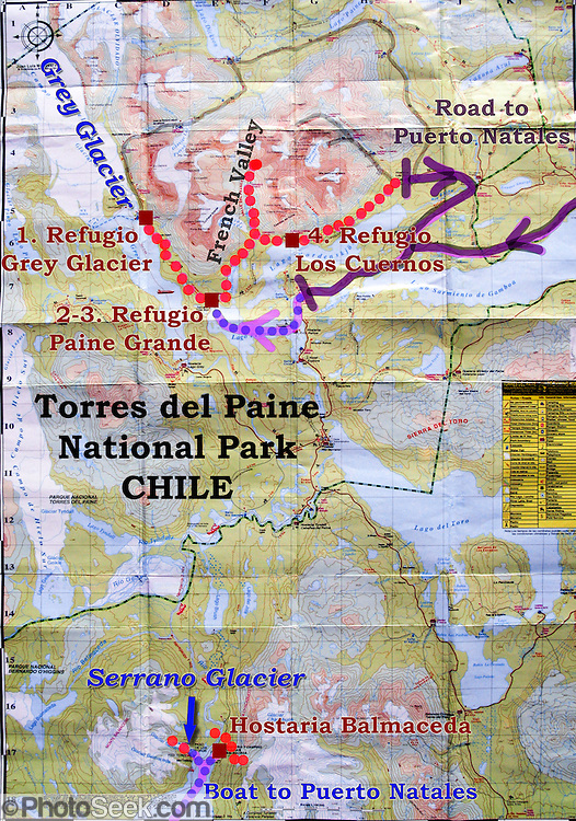 """In this map of Torres del Paine National Park (in Chile, South America), our hikes are shown as dotted red lines, including 5 days on the """"W Route"""" and 2 days at Hostaria Balmaceda and the Serrano Glacier. The pink arrows with dotted blue lines are ferry routes. The purple lines are the park roads which connect to Puerto Natales off the map. In Chile, Patagonia includes the territory of Valdivia through Tierra del Fuego archipelago. In Chile, Patagonia includes the territory of Valdivia through Tierra del Fuego archipelago. Spanning both Argentina and Chile, the foot of South America is known as Patagonia, a name derived from coastal giants (""""Patagão"""" or """"Patagoni"""" who were actually Tehuelche native people who averaged 25 cm taller than the Spaniards) who were reported by Magellan's 1520s voyage circumnavigating the world."""