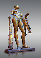Gilded bronze 1st century AD Roman statue of Hercules found buried near Pompey's Theatre having possibly been struck by lightening and given a customary Roman burial. A Roman copy of a Hellenistic Athenian staue from around 390-370 BC, Vatican Museum Rome, Italy,  grey background ..<br /> <br /> If you prefer to buy from our ALAMY STOCK LIBRARY page at https://www.alamy.com/portfolio/paul-williams-funkystock/greco-roman-sculptures.html . Type -    Vatican    - into LOWER SEARCH WITHIN GALLERY box - Refine search by adding a subject, place, background colour, museum etc.<br /> <br /> Visit our CLASSICAL WORLD HISTORIC SITES PHOTO COLLECTIONS for more photos to download or buy as wall art prints https://funkystock.photoshelter.com/gallery-collection/The-Romans-Art-Artefacts-Antiquities-Historic-Sites-Pictures-Images/C0000r2uLJJo9_s0c
