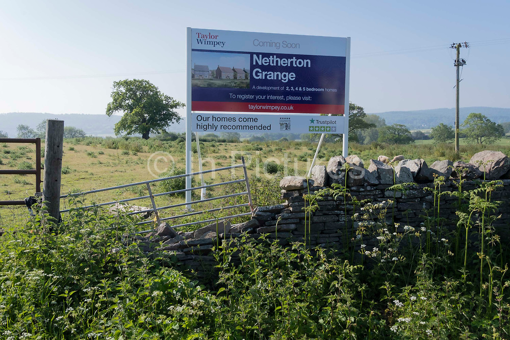 An idyllic landscape of green fields and farmland that will soon change forever when it will be built upon by housing developer Taylor Wimpey at Netherton Grange, Youngwood Lane, Nailsea, on 31st May 2021, in Nailsea, North Somerset, England. Nearly 170 homes are set to be built here on the edge of Nailsea after detailed plans were approved. Thirty per cent of the homes will be affordable.