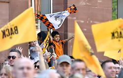 Supporters wave flags and banners ahead of the winner's parade through Wolverhampton.