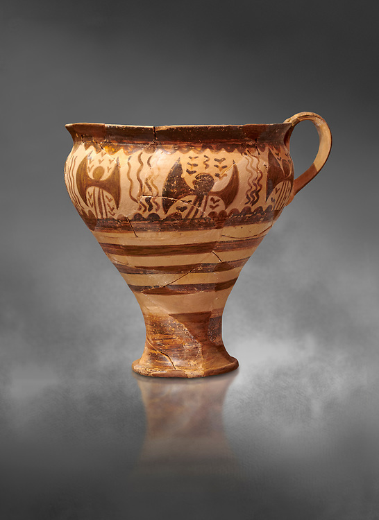 Minoan decorated cup for export decorated with a double axe, Kommos Harbour 1600-1450 BC; Heraklion Archaeological  Museum, grey background. .<br /> <br /> If you prefer to buy from our ALAMY PHOTO LIBRARY  Collection visit : https://www.alamy.com/portfolio/paul-williams-funkystock/minoan-art-artefacts.html . Type -   Heraklion   - into the LOWER SEARCH WITHIN GALLERY box. Refine search by adding background colour, place, museum etc<br /> <br /> Visit our MINOAN ART PHOTO COLLECTIONS for more photos to download  as wall art prints https://funkystock.photoshelter.com/gallery-collection/Ancient-Minoans-Art-Artefacts-Antiquities-Historic-Places-Pictures-Images-of/C0000ricT2SU_M9w