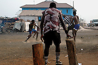 GHANA,Accra,Jamestown, 2007. Soccer is Ghana's national obsession, played out hard and fast on a makeshift pitch near the fish market.