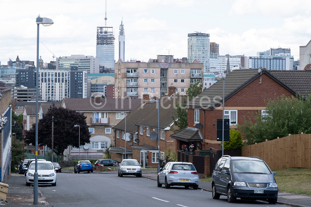 View looking down across old industrial buildings and residential buildings from Highgate over Deritend and Digbeth towards the City Centre on 3rd August 2020 in Birmingham, United Kingdom. Birmingham is undergoing a massive transformation called the Big City Plan which involves the controversial regeneration of the city centre as well as a secondary zone reaching out further. The Big City Plan is the most ambitious, far-reaching development project being undertaken in the UK. The aim for Birmingham City Council is to create a world-class city centre by planning for the next 20 years of transformation.