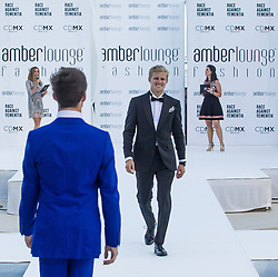 May 25, 2018 - Montecarlo, Monaco - Marcus Ericsson of Sweden and Sauber Team driver presents a creation of Alessandra Vicedomini at the 15th Amber Lounge Charity Fashion Show 2018 in Monte Carlo, Monaco. (Credit Image: © Robert Szaniszlo/NurPhoto via ZUMA Press)
