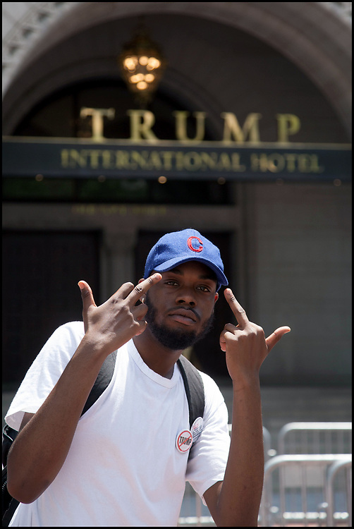 A protestor in front of Trump International Hotel In Washington, DC on June 28, 2018.