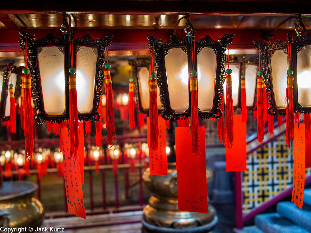 10 AUGUST 2013 - HONG KONG:  Lanterns hang from the ceiling in Man Mo Temple in Hong Kong. Hong Kong is one of the two Special Administrative Regions of the People's Republic of China, Macau is the other. It is situated on China's south coast and, enclosed by the Pearl River Delta and South China Sea, it is known for its skyline and deep natural harbour. Hong Kong is one of the most densely populated areas in the world, the  population is 93.6% ethnic Chinese and 6.4% from other groups. The Han Chinese majority originate mainly from the cities of Guangzhou and Taishan in the neighbouring Guangdong province.      PHOTO BY JACK KURTZ