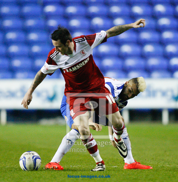 Lee Tomlin of Middlesborough  (front) is challenged by Daniel Williams of Reading during the Sky Bet Championship match at the Madejski Stadium, Reading<br /> Picture by Andrew Tobin/Focus Images Ltd +44 7710 761829<br /> 22/04/2014