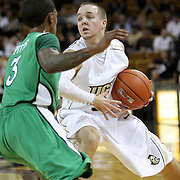 Marshall guard Damier Pitts (3) defends against Central Florida guard A.J. Rompza (3) during a Conference USA NCAA basketball game between the Marshall Thundering Herd and the Central Florida Knights at the UCF Arena on January 5, 2011 in Orlando, Florida. Central Florida won the game 65-58 and extended their record to 14-0.  (AP Photo/Alex Menendez)