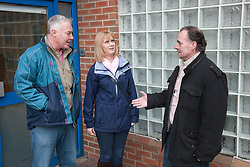 Tenants and housing officer at entrance to flats.