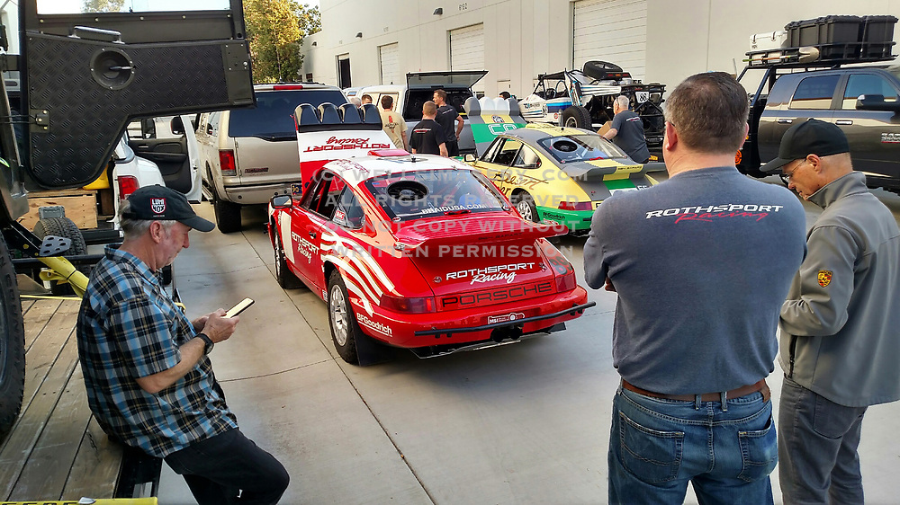"""Image of the """"Red Sled"""" Porsche 964 prepping to compete in the 2017 NORRA Mexican 1000 with the Rothsport Racing Team by Randy Wells"""