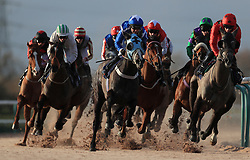 Horses take the first bend in the Betway Live Casino Handicap at Southwell Racecourse.