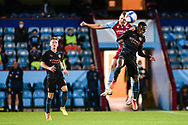 Tom Pugh (30) of Scunthorpe United Claudio Gomes of Man City u21 battles for possession during the EFL Trophy match between Scunthorpe United and Manchester City at Glanford Park, Scunthorpe, England on 29 September 2020.