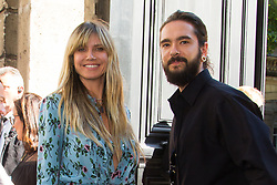 File photo - Heidi Klum and boyfriend Tom Kaulitz arrives at Valentino fashion show during Haute Couture Fall/Winter 2019-2020 in Paris on July 03, 2019. The model and former Project Runway host, 46, and Kaulitz, the 29-year-old guitarist for German band Tokio Hotel, swapped vows in February, according to multiple reports. Photo by Nasser Berzane/ABACAPRESS.COM