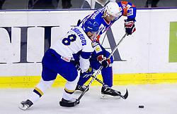 Talgat Zhailauov of Kazakhstan vs Sabahudin Kovacevic of Slovenia during friendly ice-hockey match between National teams of Slovenia and Kazakhstan, on April 12, 2011 at Hala Tivoli, Ljubljana, Slovenia. Kazakhstan defeated Slovenia 3-0.  (Photo By Vid Ponikvar / Sportida.com)