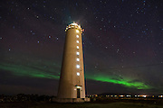 Lighthouse and Northern lights in Reykjavik harbour, Iceland