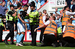 A policeman holds back Sergio Aguero of Manchester City as he argues with a steward. - Mandatory by-line: Alex James/JMP - 26/08/2017 - FOOTBALL - Vitality Stadium - Bournemouth, England - Bournemouth v Manchester City - Premier League