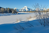 I made Oxbow Bend my last stop before leaving Grand Teton National Park. I thought I wouldn't need my snowshoes since I was just going to take a few quick pictures. But the snow was up to my waist, making it very difficult to get to the edge of the Snake River. A heavy frost was coating everything along the river.