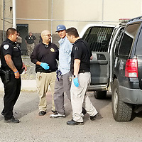 Gallup Police officers and McKinley County Adult Detention Center personnel escort Jeffrey Webster, 43, of Gallup, back into the jail after he allegedly escaped Saturday evening in Gallup.