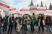 "Anti-fracking protesters gathered outside parliament while MP's debate the future of shale. <br /> The protest comes as a group of MPs also warn that fracking must be stopped in the UK because it is ""incompatible"" with climate change targets and could increase the risk of environmental damage to public health. Westminster, London, United Kingdom."