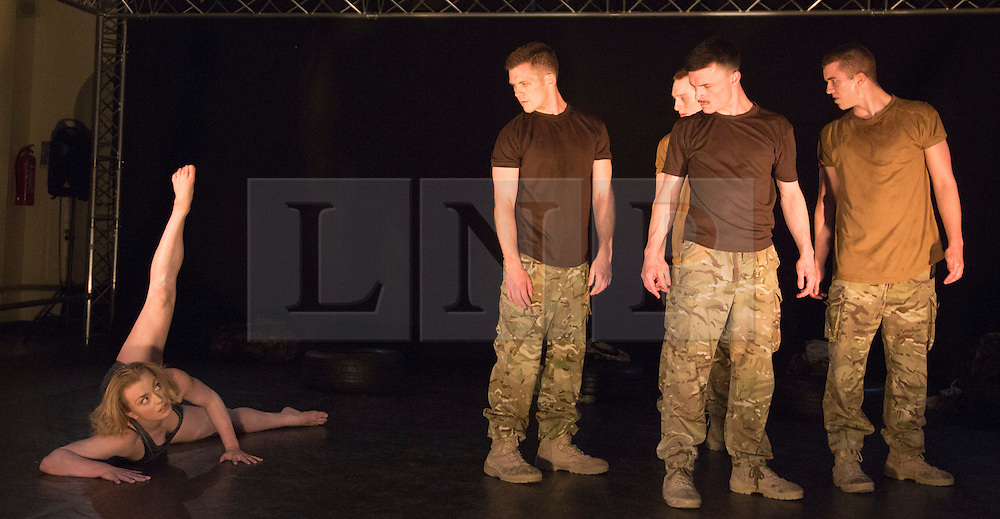 """© Licensed to London News Pictures. 07/05/2015. London, England. Female solo performed by Shelley Eva Haden with Worship of the female soldier. The Rosie Kay Dance Company perform """"5 Soldiers: The Body is the Frontline"""" at The Rifles Officers' Club in Mayfair, London from 7 to 9 May 2015 before continuing a UK tour. 5 Soldiers gives an intimate view of the training that provides soldiers for combat and warfare and how the experience affects those that put their life on the line. Dancers: Duncan Anderson, Shelley Eva Haden, Chester Hayes, Sean Marcs and Oliver Russell. Choreographed and directed by Rosie Kay.  Photo credit: Bettina Strenske/LNP"""