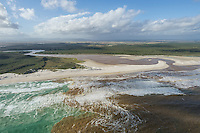 Aerial view of the Heuningnes Estuary in heavy flood and depositing heavy silt loads into the sea, De Mond Nature Reserve, Western Cape, South Africa