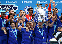 Football - 2014 / 2015 Premier League - Chelsea vs. Sunderland.   <br /> <br /> Chelsea's John Terry receives the Premiership trophy and raises it in celebration to the crowd at Stamford Bridge<br /> <br /> COLORSPORT/DANIEL BEARHAM