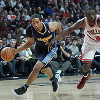 26 March 2012: Denver Nuggets point guard forward Andre Miller (24) drives past Chicago Bulls small forward Luol Deng (9)  during the Denver Nuggets 108-91 victory over the Chicago Bulls at the United Center, Chicago, Illinois, USA. NOTE TO USER: User expressly acknowledges and agrees that, by downloading and or using this photograph, User is consenting to the terms and conditions of the Getty Images License Agreement. Mandatory Credit: 2012 NBAE (Photo by Chris Elise/NBAE via Getty Images)