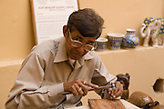 India, Rajasthan, Jaipur, Amber fort built 1592 An Engraver at work