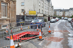 A sinkhole on Murano Place awaits repair after being opened up by a council Bin Lorry late on Thursday night