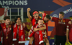 LIVERPOOL, ENGLAND - Wednesday, July 22, 2020: Liverpool's Curtis Jones and Harvey Elliott celebrate after being crowned Premier League champions after the FA Premier League match between Liverpool FC and Chelsea FC at Anfield. The game was played behind closed doors due to the UK government's social distancing laws during the Coronavirus COVID-19 Pandemic. Liverpool won 5-3. (Pic by David Rawcliffe/Propaganda)