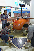 SHANGHAI, CHINA - NOVEMBER 03: (CHINA OUT) <br /> <br /> Prototype Aeroplane To Probe The Planet Mars Appears In Shanghai<br /> <br /> The technicians install self-developed prototype aeroplane to be shown at 2014 China International Industry Fair on November 3, 2014 in Shanghai, China. 2014 China International Industry Fair will be held at Shanghai International Expo Center from November 4 to November 8 and prototype aeroplane for probing the planet Mars is one of exhibits to be shown.<br /> ©Exclusivepix