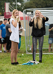 © Licensed to London News Pictures. 05/09/2014. Isle of Wight, UK. Festival goers at Bestival 2014 Day 2 Friday brush their teeth and wash themselves in the morning.  This weekend's headliners include Chic featuring Nile Rodgers, Foals and Outcast Photo credit : Richard Isaac/LNP